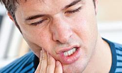 dente dolorido ao mastigar