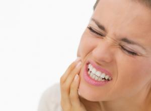 dente com curativo doendo muito