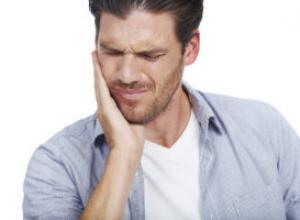 dente dolorido após canal